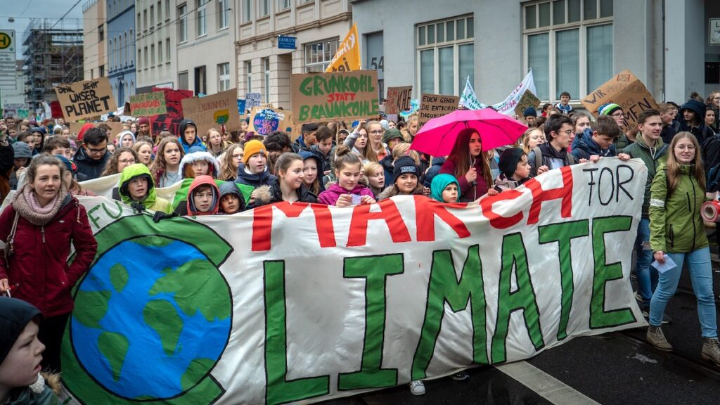 People rallying behind a march for climate change
