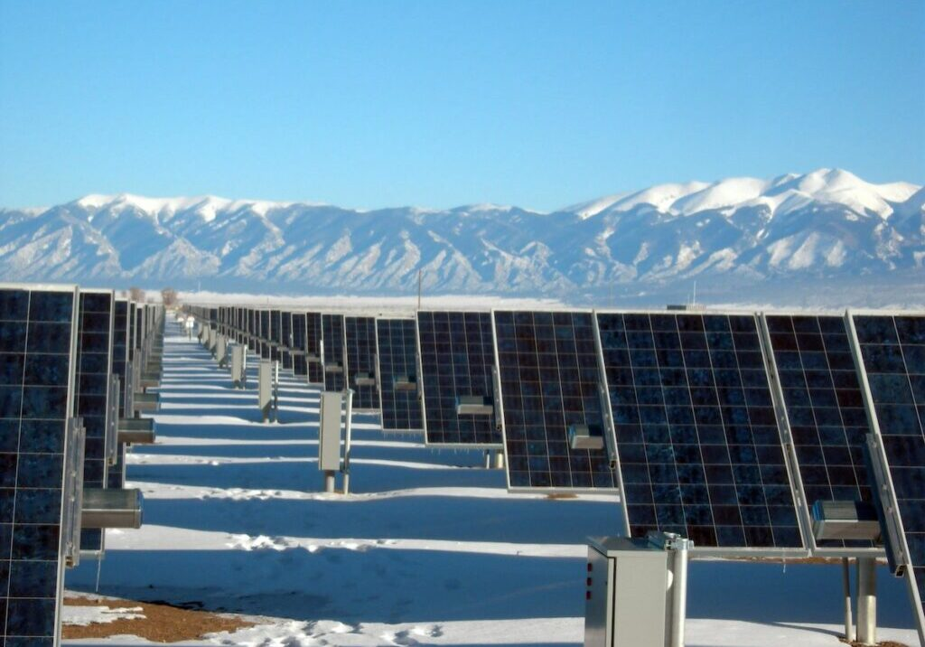 Solar panels in snowy mountains